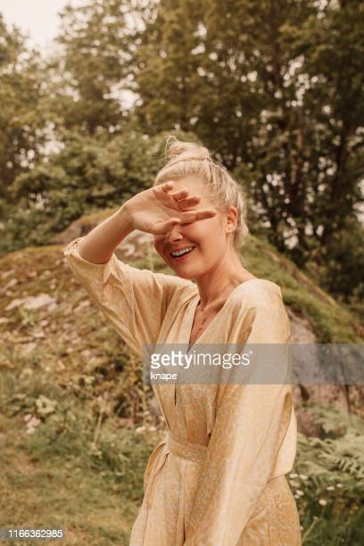 fashionable woman summer portrait outdoors in nature - satin dress stock pictures, royalty-free photos & images