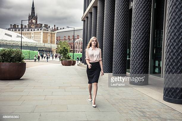 fashionable woman walking in central london - lunch break stock photos and pictures