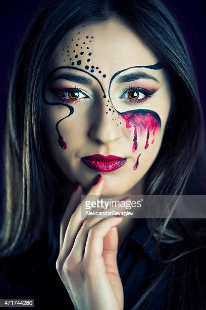 Fashionable Woman with Artistic Colorful Make-up