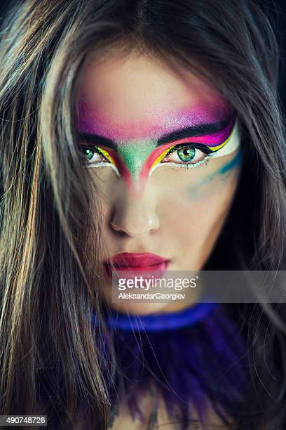 fashionable woman with artistic colorful make-up - stage make up stock photos and pictures