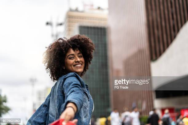 Fashionable Woman with Curly Hair at Street