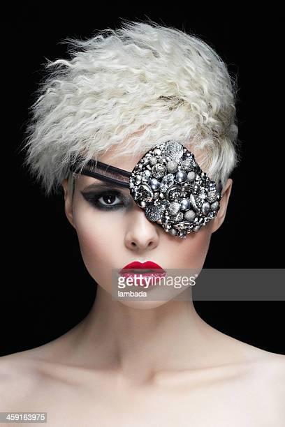 Fashionable woman with eye mask