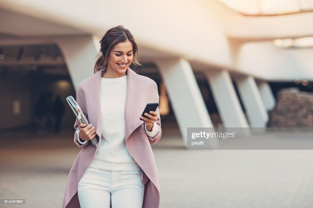 Fashionable woman with smart phone : Stock Photo