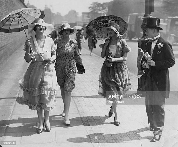 Fashionable women arrive at Lord's cricket ground for the Eton Vs Harrow match