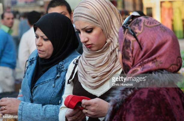 Fashionable women shop for cloth in the garment district of the fashionable Karradah neighborhood February 2 2009 in central Baghdad Iraq Baghdad's...