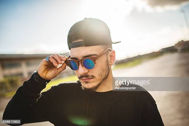 fashionable young adult looking away - all hip hop models stock photos and pictures