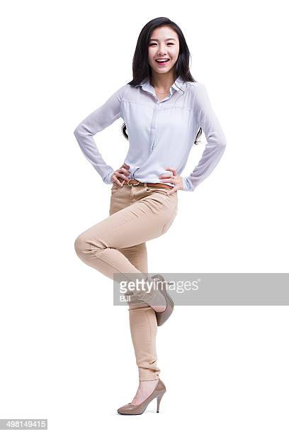 fashionable young businesswoman - standing on one leg stock pictures, royalty-free photos & images