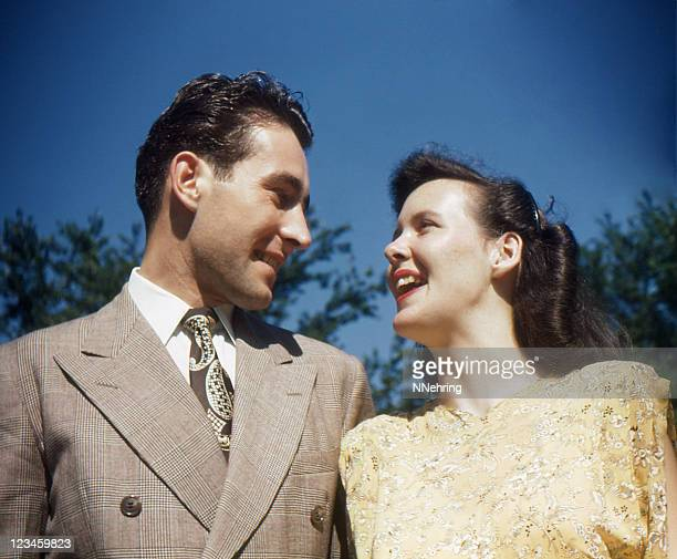 fashionable young couple looking at each other 1948, retro - 1948 stock pictures, royalty-free photos & images