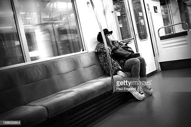 Fashionable young girl rides a Tokyo subway.