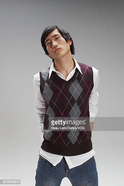 Fashionable young man in plaid sweater vest