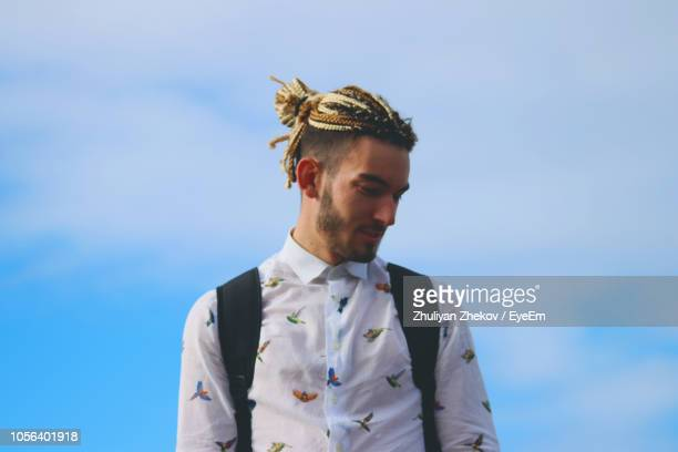 Fashionable Young Man Looking Away Against Sky