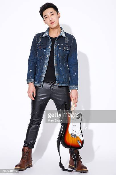 Fashionable young man with a guitar