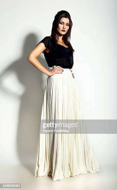 Fashionable young woman in maxi skirt