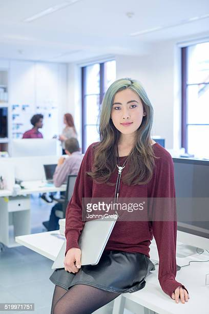 Fashionable young woman in modern office