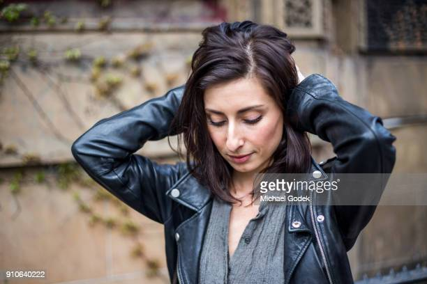 Fashionable young woman in New York City with leather jacket