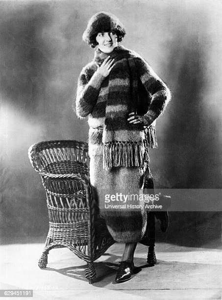Fashionable Young Woman in Skating Outfit Consisting of Matching Sweater Skirt Scarf and Hat Made of Angora Wool Portrait circa 1922