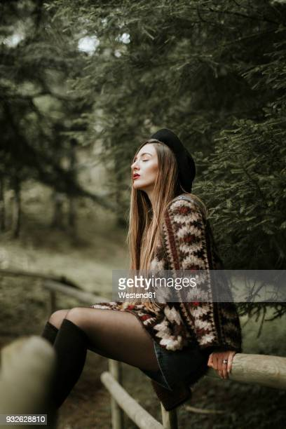 fashionable young woman relaxing in the woods - legs and short skirt sitting down stock pictures, royalty-free photos & images