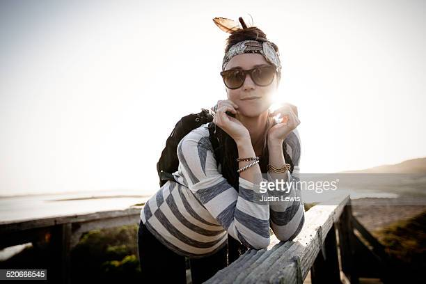 Fashionable young woman relaxing on pier
