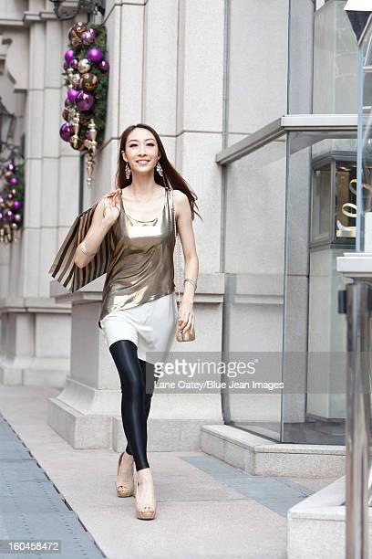 Fashionable young woman shopping in Hong Kong