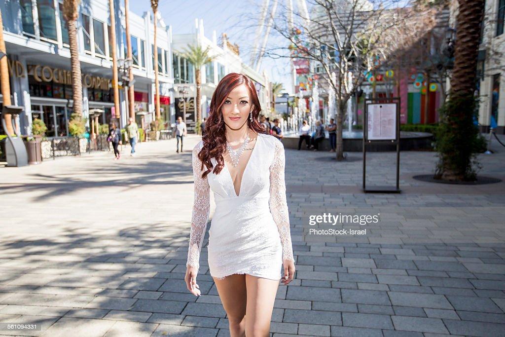 Fashionable young woman strolling on street, Las Vegas, Nevada, USA : Stock Photo