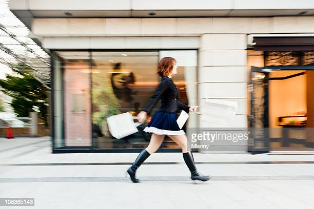 fashionable young woman tokyo shopping mall - japanese short skirts stock pictures, royalty-free photos & images