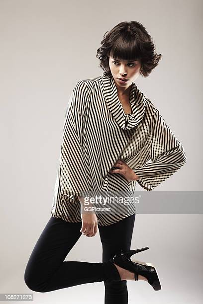 Fashionable Young Woman Wearing Striped Top