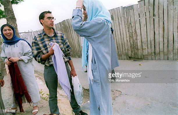 Fashionable young women try on various hejabs, the headcover for women mandated by the Islamic Republic of Iran, June 11, 2001 in Tehran, Iran....