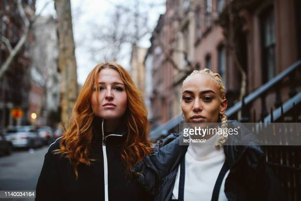 fashionable, young women with expressive attitude in lower manhattan, new york - the bronx stock pictures, royalty-free photos & images