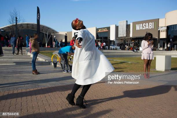 Fashionable youth gather at an outdoor area at the newly opened Mall of Africa on August 19 2017 north of Johannesburg South Africa Most of them came...