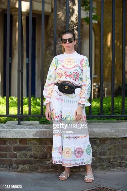 Fashionista wears Zara dress, YSL Glasses and Gucci bag during the London Fashion Week digital shows in London.