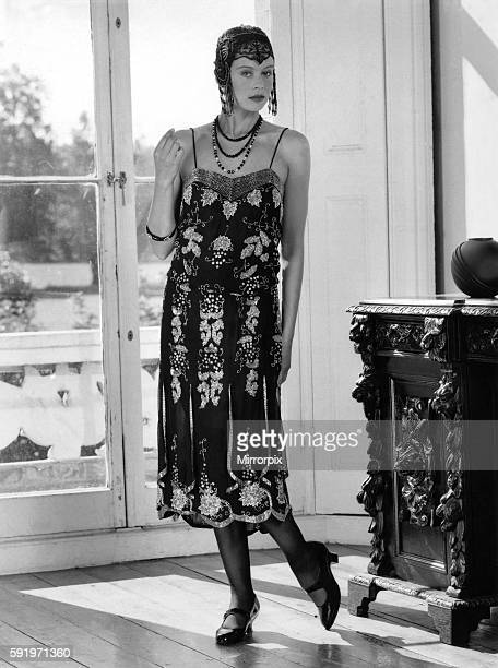 Beaded flapper dress and skull cap with neat T-bar shoes. October 1987 P008646