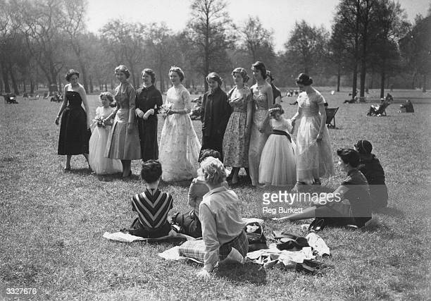 Fashions by Christian Dior are on display at a final dress rehearsal in London's Green Park for the Berkeley Debutante Dress Show in aid of the NSPCC