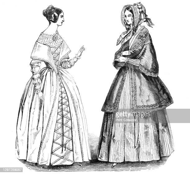 Fashions for May, 1844. 'No. 1. A Grecian hair coiffure. A Camelion silk dress, laced down the front with silk gimp cord, chemisette and sleeves of...