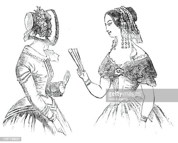 Fashions for the New Year, 1844. Left: 'A satin hat, trimmed with black lace. A camelion silk dress, with spencer corsage'. Right: 'A coiffure,...