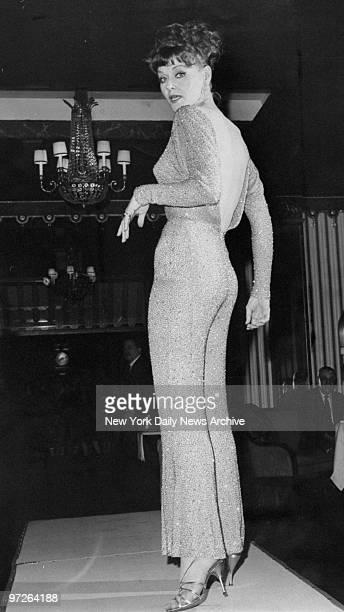 Fashions of the '60s Model Jackie Blanchard shows beaded hostess pajamas worn by Angie Dickinson in the movie The Art of Love at the WaldorfAstoria