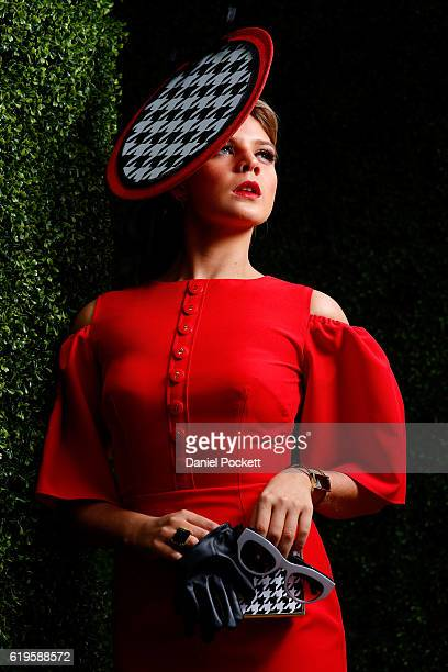 Fashions on the Field contestant poses on Emirates Melbourne Cup Day at Flemington Racecourse on November 1 2016 in Melbourne Australia