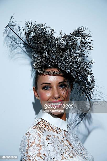 Fashions on the Field entrant poses in the Fashion on the Field enclosure on Victoria Derby Day at Flemington Racecourse on October 31 2015 in...