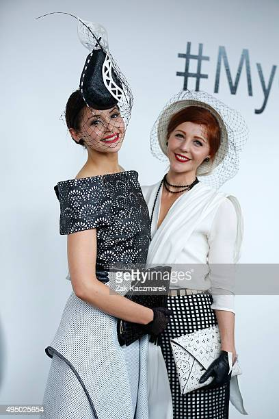 Fashions on the Field entrants pose in the Fashion on the Field enclosure on Victoria Derby Day at Flemington Racecourse on October 31 2015 in...