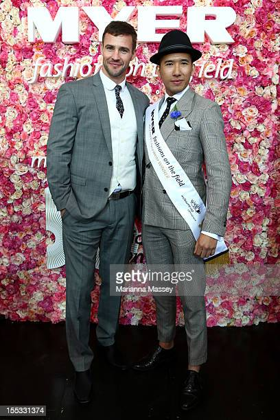 Fashions on the Field men's Racewear daily winner Peter Tran poses with model Chris Smith on Victoria Derby Day at Flemington Racecourse on November...