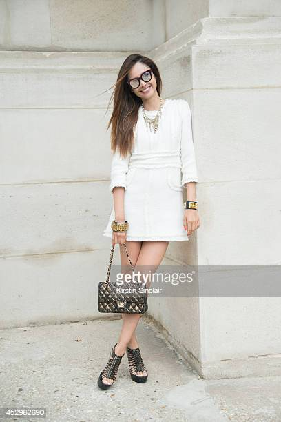 Fashon Editor and Visual Artist Patricia Contrevas wearing a Chanel bag necklace and dress Alexander McQueen shoes Hermes bracelet and Spektre...