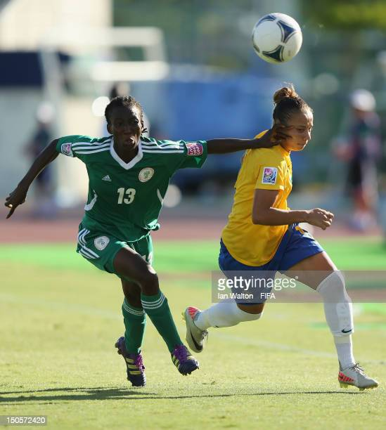 Fasilat Adeyeno of Nigeria competes for the ball with Thais Guedes of Brazil during the FIFA U20 Women's World Cup Japan 2012 Group B match between...