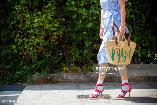 Fasion stylist and blogger Angelina Lepper wears a Cote white and blue striped top and skirt Mango bag and Manfredi Manara pink shoes on June 26 2017...