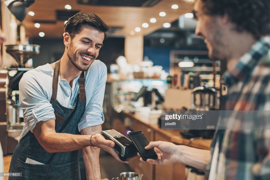 Fast and easy payment in the coffee shop : Stock Photo