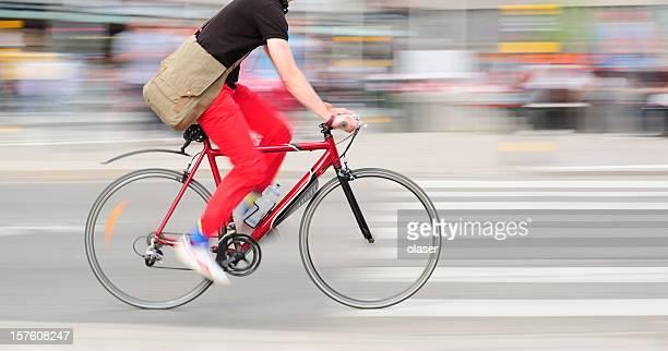 Fast bike motion blurred in traffic