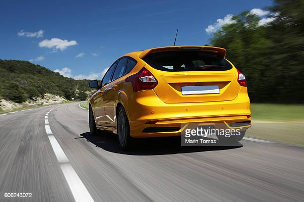 fast car driving - bumper stock pictures, royalty-free photos & images