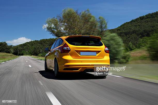 fast car driving - rear view stock pictures, royalty-free photos & images