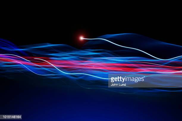 fast communications light trails - john lund stock pictures, royalty-free photos & images