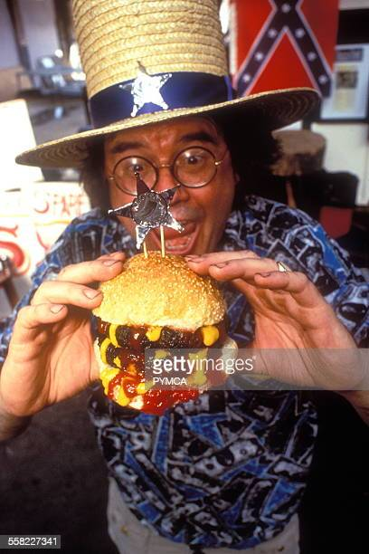 Fast Food a man eating a double burger