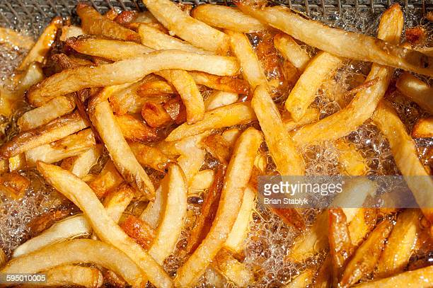 Fast food french fries cooking in fryer