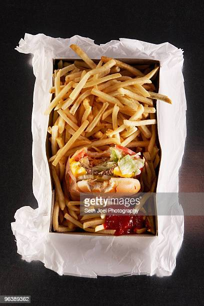 Fast food in take out box on paper bag